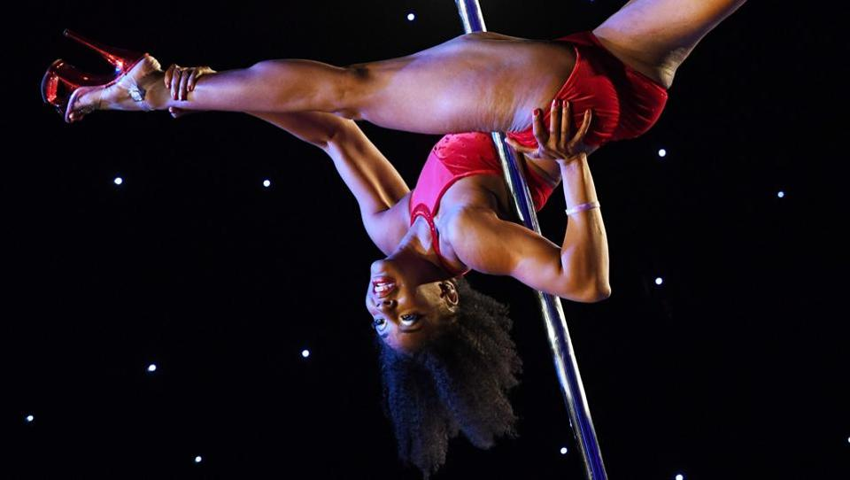 Founded by Amy Guion, a California Pole Dance Championship 2011 bronze medallist, the event grew from a small community to a national brand now competing globally. (Mark RALSTON  / AFP)