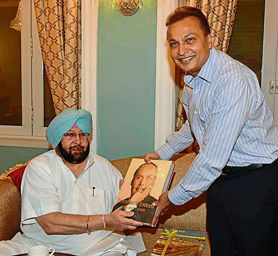 Reliance ADAG head Anil Ambani presenting a book to Punjab chief minister Capt Amarinder Singh during their meeting in Mumbai on Tuesday.