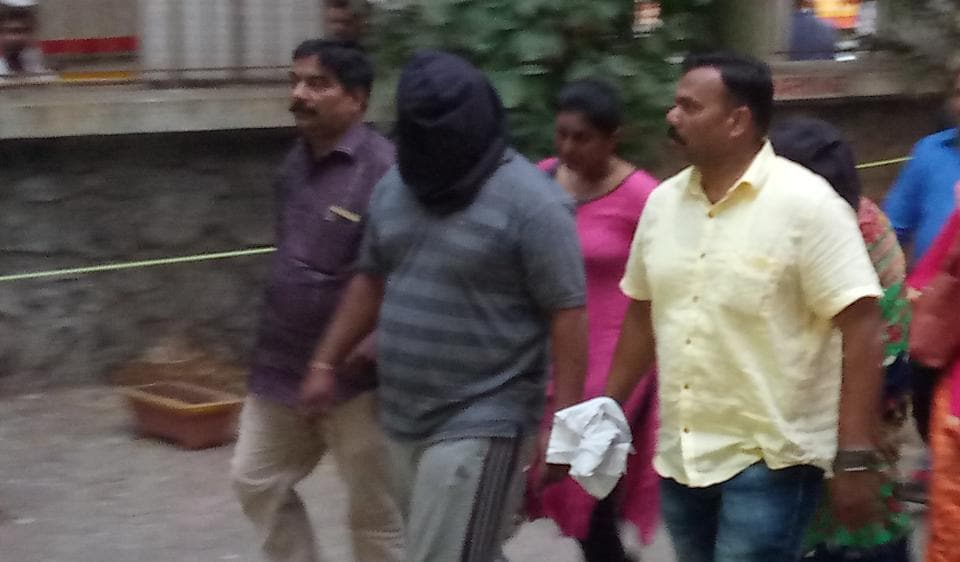 An accused being taken to a police station on Monday.
