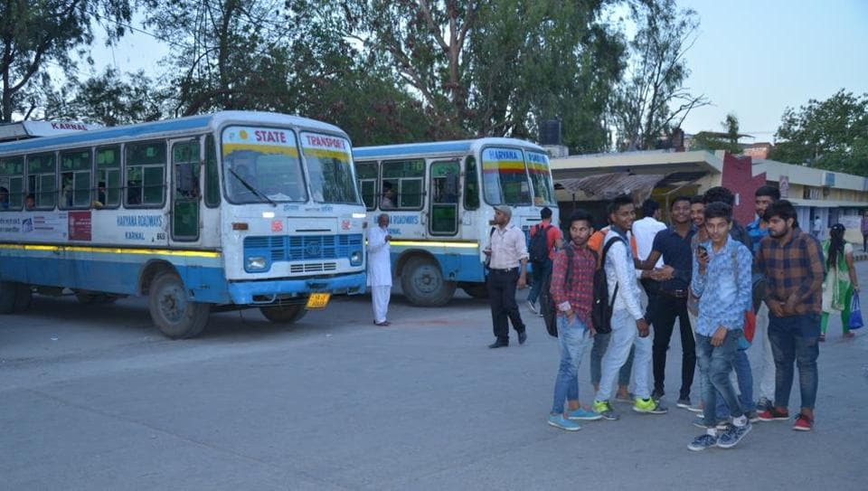 Students starnded at the Karnal bus stand on Monday.