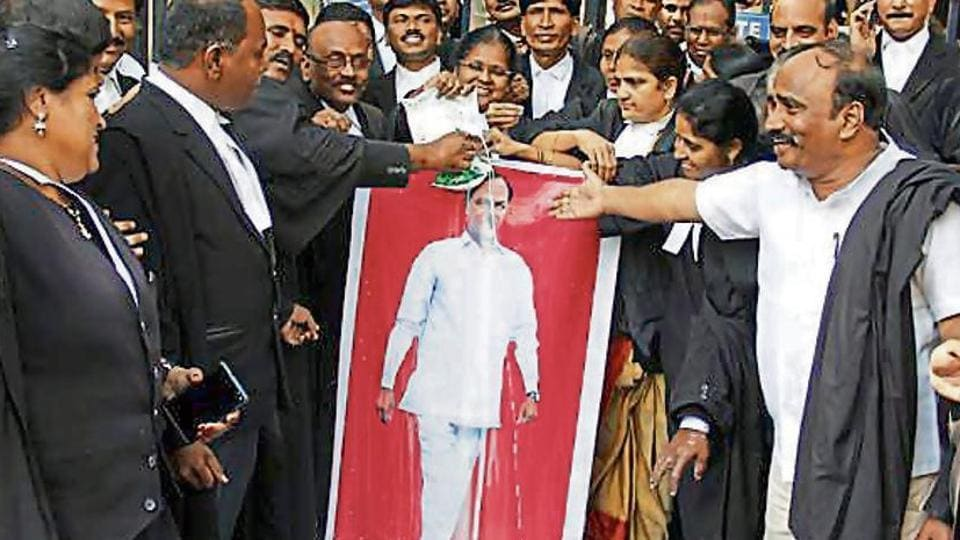 A section of Telangana high court lawyers on Tuesday pour milk on KCR's portrait after he increased the honorarium of government counsels