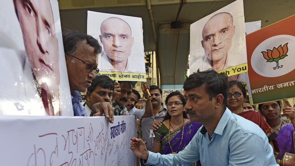 BJP workers hold a signature campaign in support of Kulbhushan Yadhav in Mumbai on Tuesday.