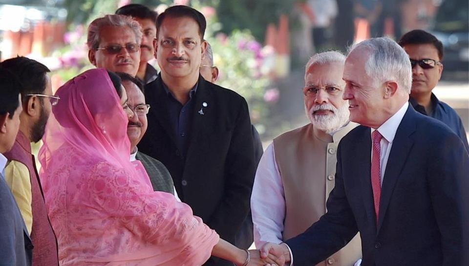 Prime Minister Narendra Modi looks on as his Australian counterpart Malcolm Turnbull shakes hand with Union minister Harsimrat Kaur Badal in New Delhi on Monday.