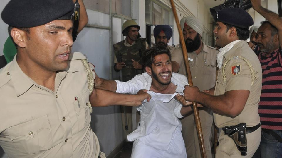 A student in confrontation with police at Panjab University, Chandigarh, on Tuesday, April 11.