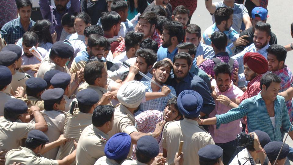 ABVP members in scuffle with police opposite the VC office at PU in Chandigarh on Monday.