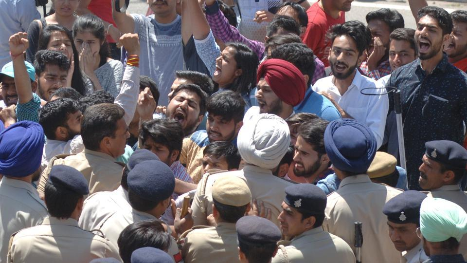 ABVP activists during their protest in front of VC's office at Panjab University in Chandigarh on Monday.