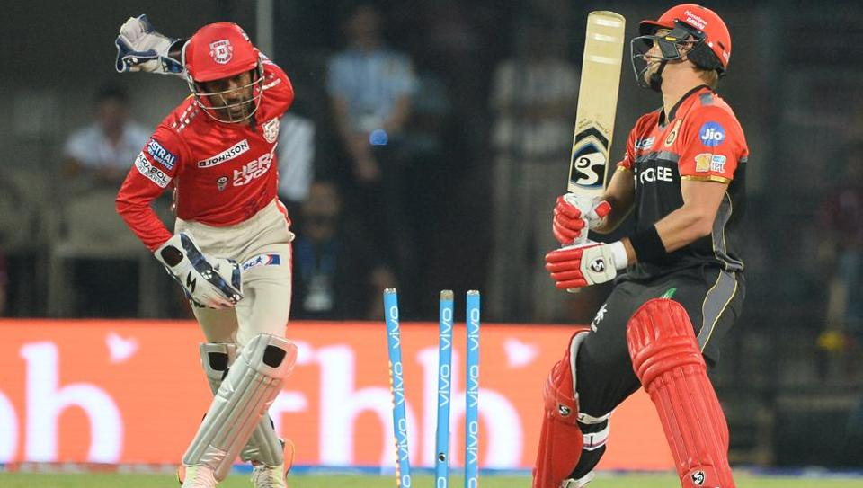 Royal Challengers Bangalore batsman Shane Watson is bowled as Kings XI Punjab wicketkeeper Wriddhiman Saha celebrates the dismissal during the 2017 Indian Premier League Twenty20 cricket match at the Holkar Stadium in Indore on Monday.
