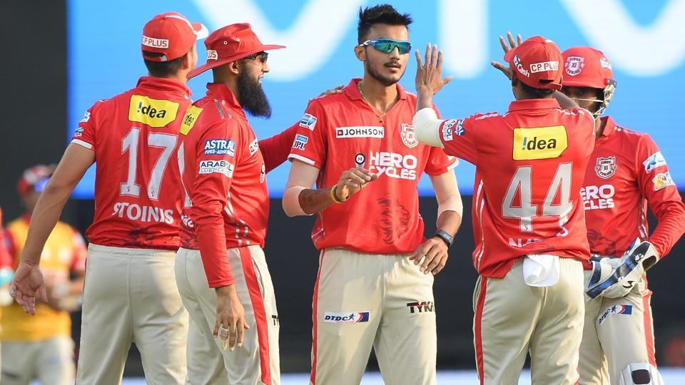 Kings XI Punjab bowler Axar Patel (C) celebrates after dismissing Rising Pune Supergiant batsman Ben Stokes in IPL2017.