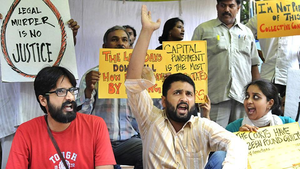 Activists protest against death penalty law.