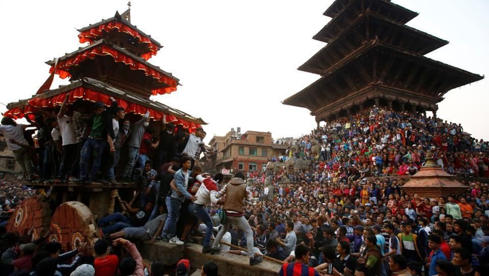 People throng the Nyatapola Temple in Bhaktapur to celebrate the 9 days long festival. (Navesh Chitrakar/REUTERS)