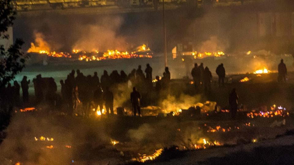 At least 10 injured in the fire apparently started deliberately at the Grande-Synthe migrant camp outside the northern French city of Dunkirk.