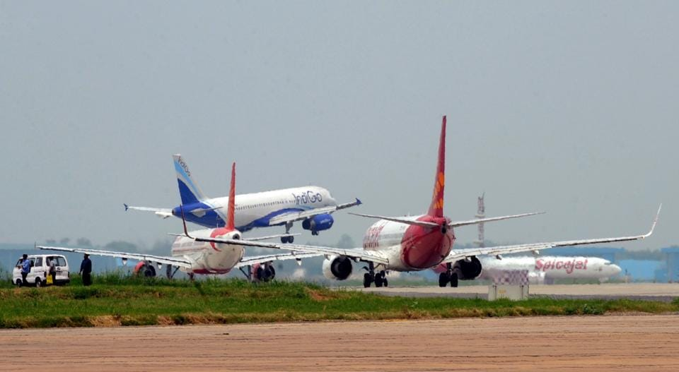 Aircraft from Indigo (C), Air India (L) and Spicejet (R) jostle for space on a runway at Indira Gandhi International Airport in New Delhi.