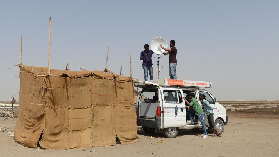 Programme co-ordinators for Agariya Heet Rakshak Manch set up an Internet-connected van for a tent school workshop for a group of children of salt pan workers in the Little Rann of Kutch. (AFP)