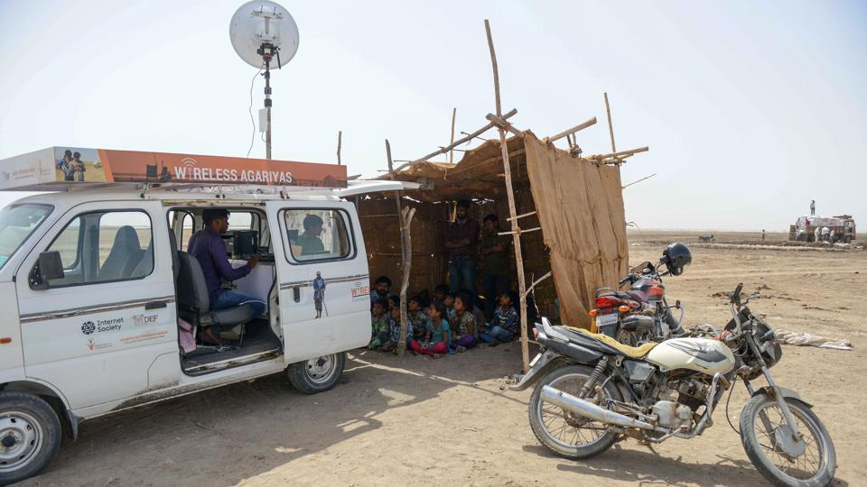 The mobile van workshops for the children in progress providing them online access. Located in a remote corner of western Gujarat, where there is no power supply, it is an out of the world experience for the kids. (AFP)