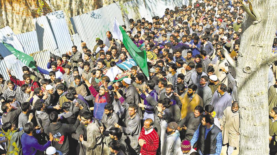 Villagers carry the body of youth Umar Farooq at his funeral in Baroosa, in central Kashmir's Ganderbal district on April 10. Eight people were killed in Kashmir on April 9 when police opened fire at protesters who stormed polling stations during a by-election for Srinagar Lok Sabha seat.
