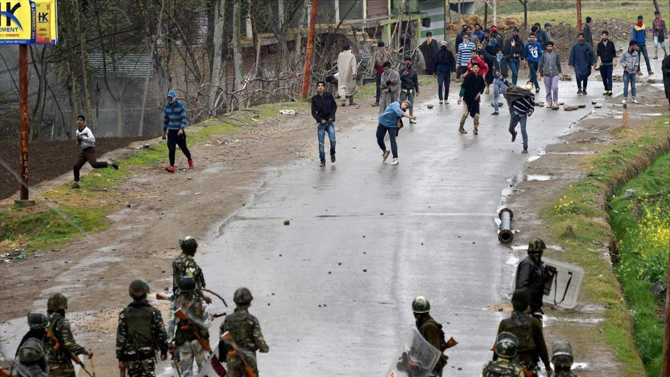 A group of youth pelting stones on security forces during an anti-militant operation at village Durbugh in Chadoora area of central Kashmir's Budgam district.