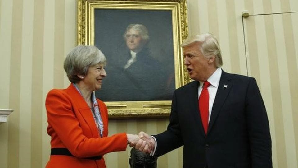 US President Donald Trump meets with British Prime Minister Theresa May in the White House Oval Office in Washington.