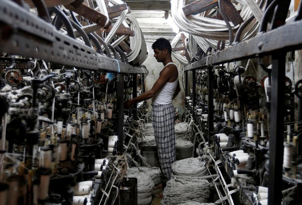 An employee works inside a garment factory in Mumbai, India February 28, 2017. REUTERS/Danish Siddiqui