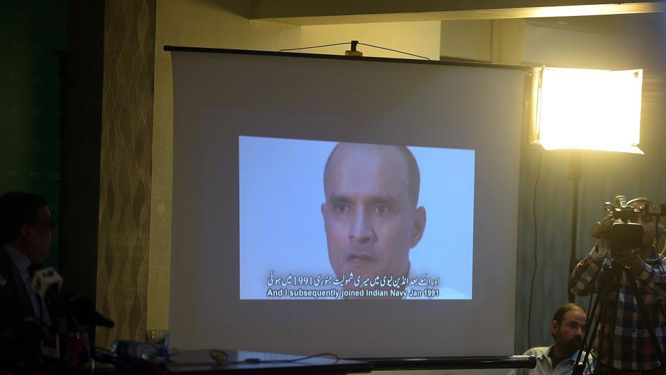 In this file photograph, Pakistani journalists watch a video showing Indian national Kulbhushan Yadav, arrested on suspicion of spying, during a press conference in Islamabad.