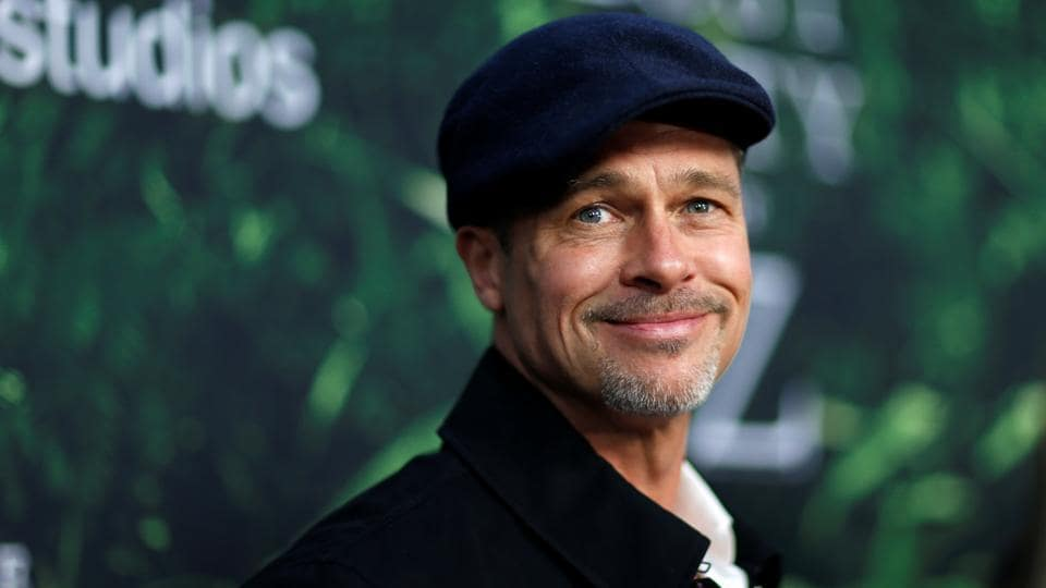 Producer Brad Pitt poses at the premiere of the movie The Lost City of Z in