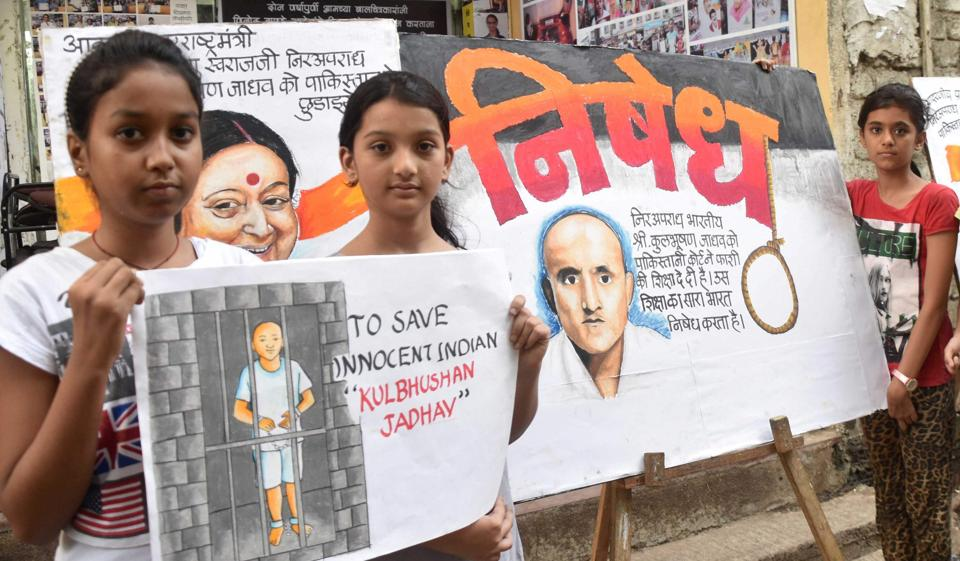 Girls protest against a Pakistan court awarding death sentence to retired Indian naval officer Kulbhushan Jadhav in Mumbai on Tuesday.