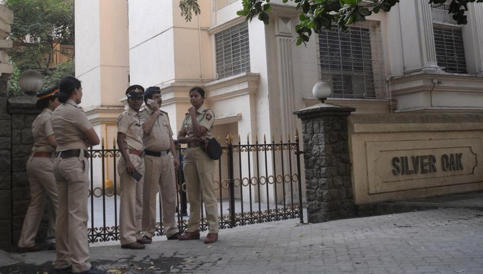 Police personal wait outside Kulbhushan Jadhav's residence in Mumbai on Monday.