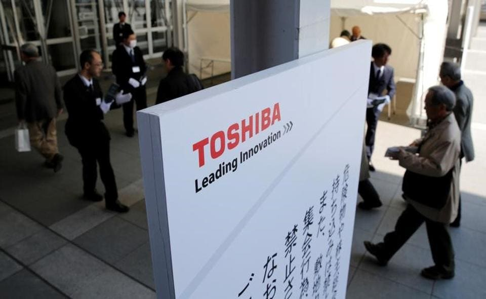 Shareholders arrive at Toshiba's extraordinary shareholders meeting in Chiba, Japan March 30, 2017.