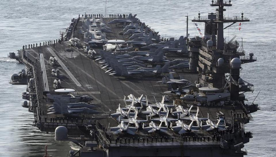 The Carl Vinson strike group cancelled a planned trip to Australia this weekend to head to the region, in a show of force as Washington signalled it may act to shut down Pyongyang's nuclear capabilities.
