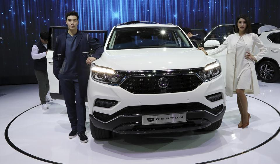Models pose with Ssangyong Motor's G4 Rexton, sports utility vehicle or SUV, during a media preview of the 2017 Seoul Motor Show in Goyang, South Korea.