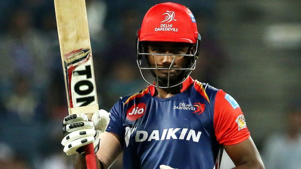 Sanju Samson of Delhi Daredevil raises his bat after scoring his century against Rising Pune Supergiant.
