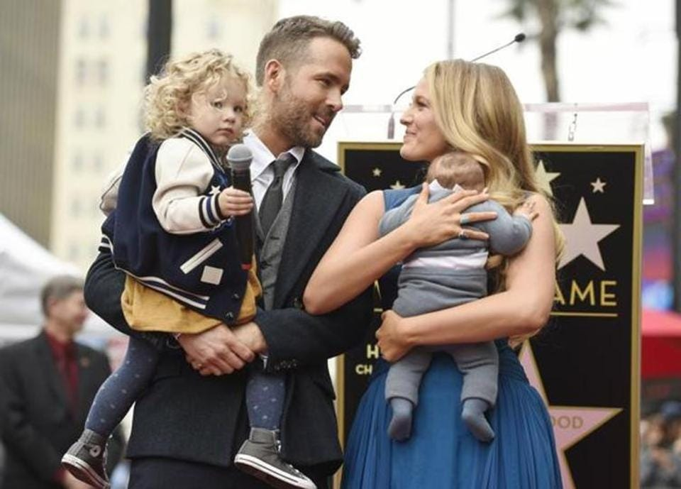 Actors Ryan Reynolds and Blake Lively with their daughters James, left, and Ines during a Hollywood Walk of Fame ceremony in Los Angeles in December 2016.