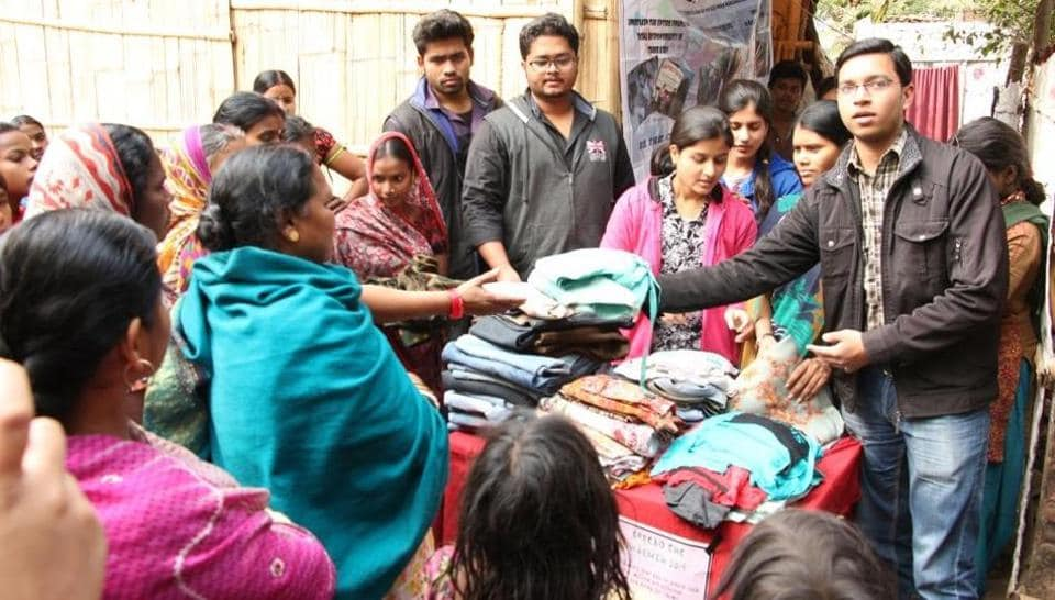BIT-Patna students distributing clothes to families of underprivileged children.