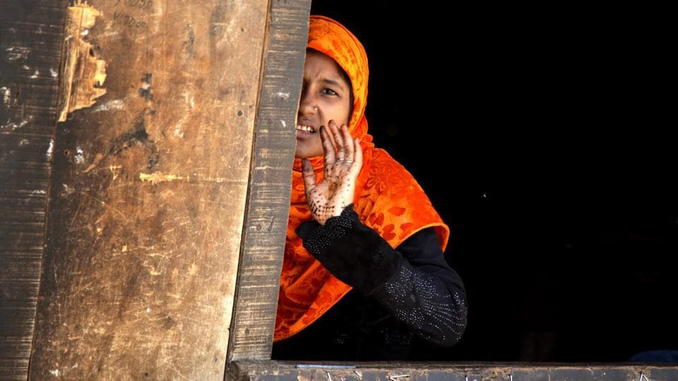 A Rohingya Muslim woman reacts to camera at a refugee camp on the outskirts of Jammu. According to news reports, Indian government plans to deport Rohingya Muslims who belong to Myanmar mostly living in Jammu and Samba districts of Jammu region.  (Nitin Kanotra/HT Photo)