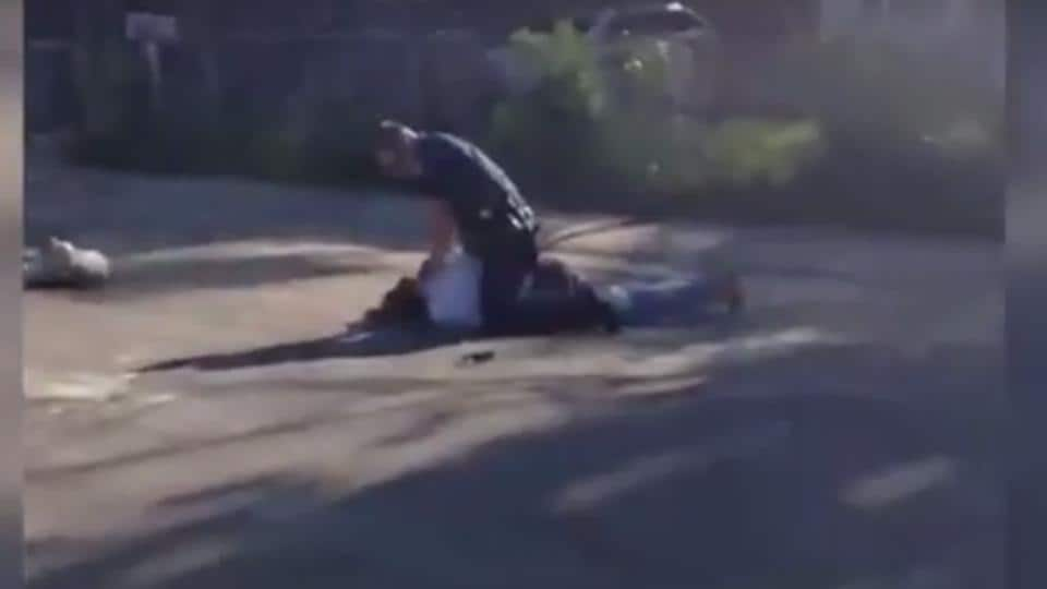 A video grab of the cop punching the jaywalker.