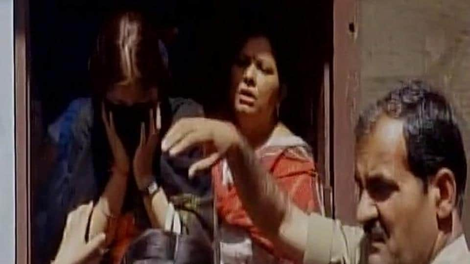 The woman being brought out of the rented accommodation in Meerut by police on Tuesday.
