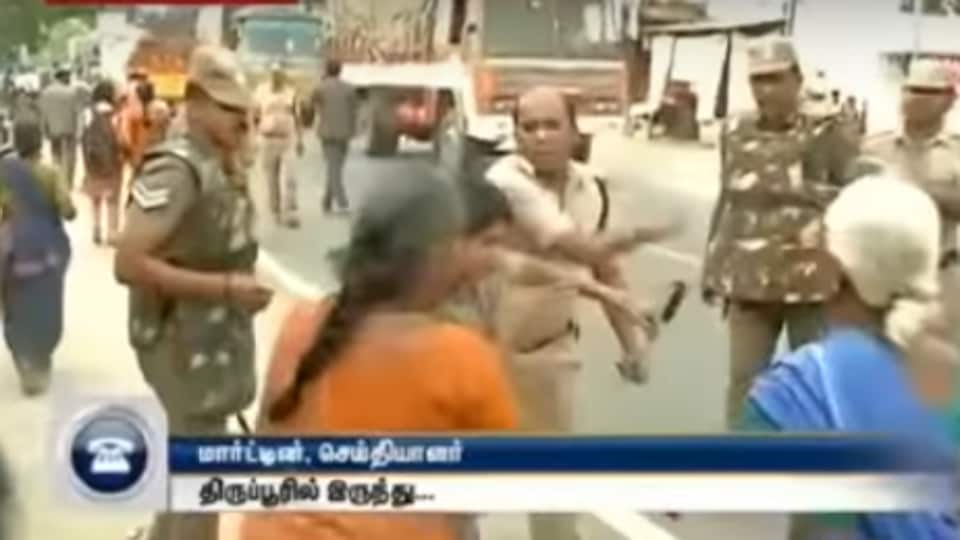 A cop allegedly slapped a woman and shoved two protesters who were demonstrating against liquor shops in Tirupur, Tamil Nadu.