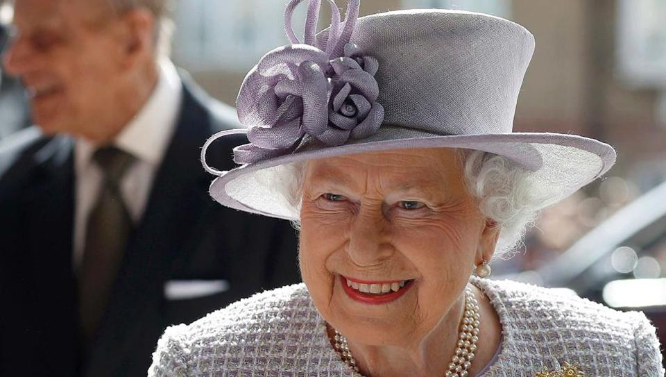 Britain's Queen Elizabeth II and her husband Britain's Prince Philip, Duke of Edinburgh arrive for their tour of Priory View, an independent living scheme for older residents, in Dunstable, north-west of London.