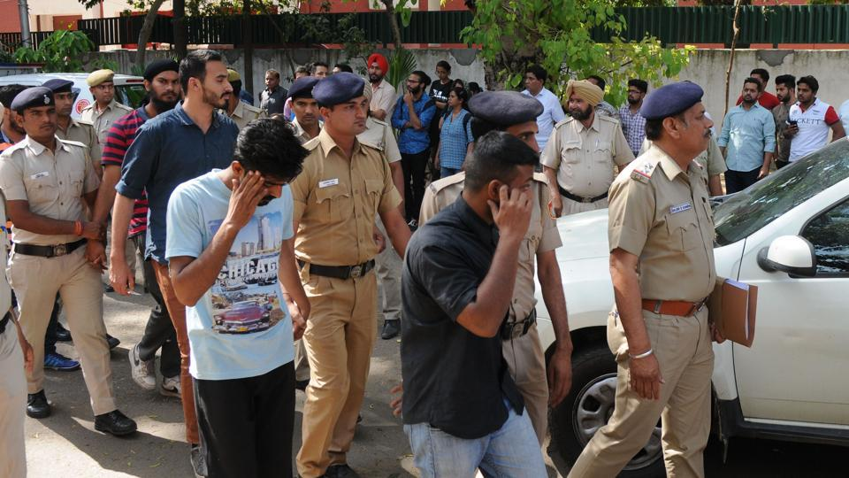 Arrested students being taken to court by police in Chandigarh on Wednesday, April 12.