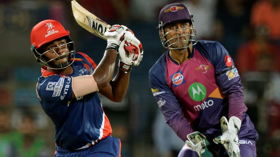 Delhi Daredevils batsman Sanju Samson plays a shot as Rising Pune Supergiant wicketkeeper Mahendra Singh Dhoni watches during the 2017 Indian Premier League Twenty20 match between Delhi Daredevils and Rising Pune Supergiant at the Maharashtra Cricket Association Stadium in Pune on Tuesday.