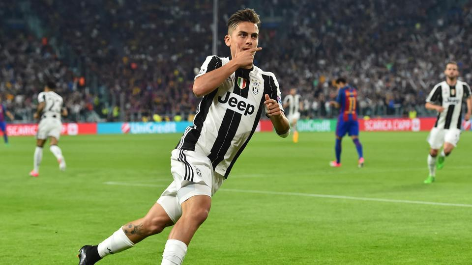 Juventus F.C.'s forward Paulo Dybala celebrates after scoring during the UEFA Champions League quarterfinal first leg match against FCBarcelona on Tuesday.