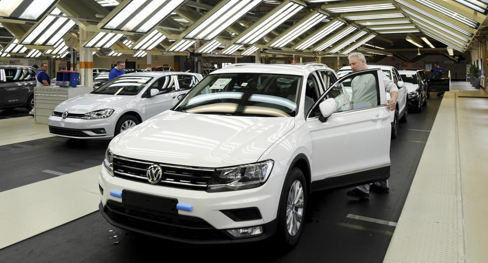 Employees work at the production line of Volkswagen Tiguan cars in the Volkswagen plant in Wolfsburg, Germany.