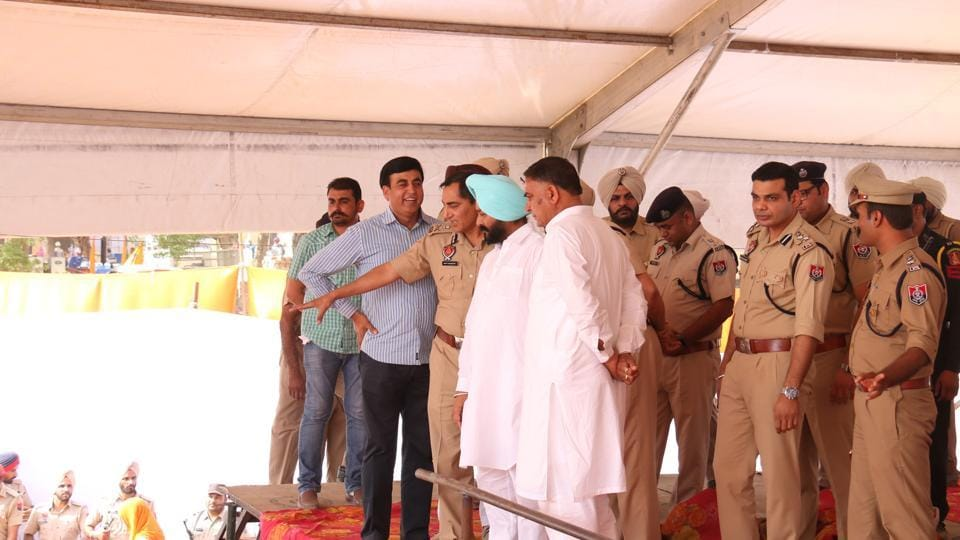 Congress leaders and police officials inspecting preparations for the rally.