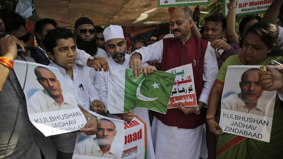 Members of Bharatiya Janata Party Minority Morcha burn a Pakistani flag during a protest against the conviction of a retired Indian naval officer Kulbhushan Jadhav, in Mumbai on Wednesday.