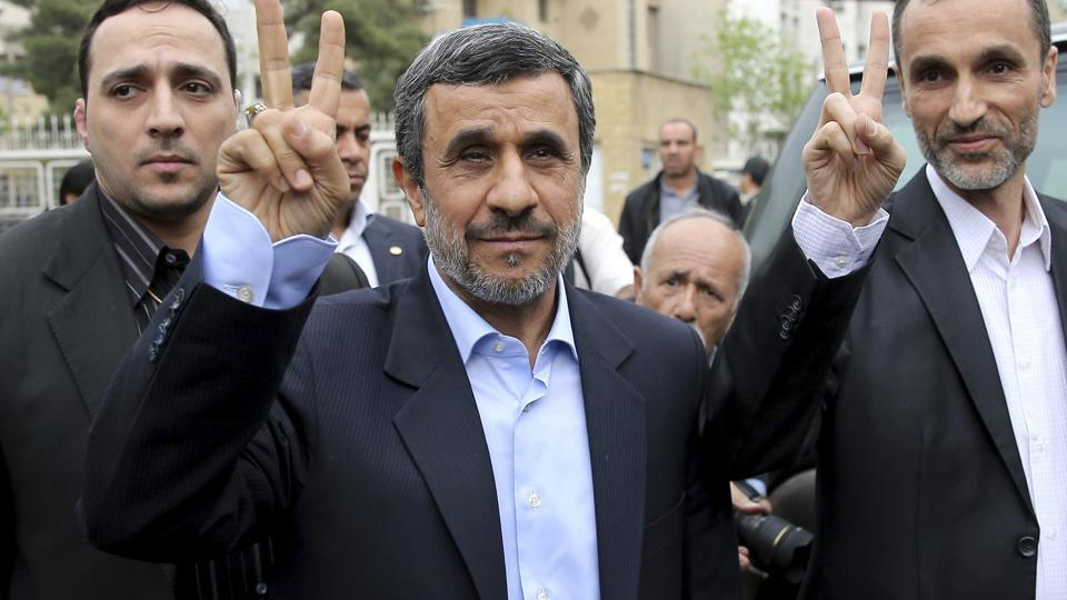 Former Iranian president Mahmoud Ahmadinejad and his close ally Hamid Baghaei flash the victory sign as they arrive at the interior ministry to register their candidacy for the upcoming presidential elections, in Tehran.