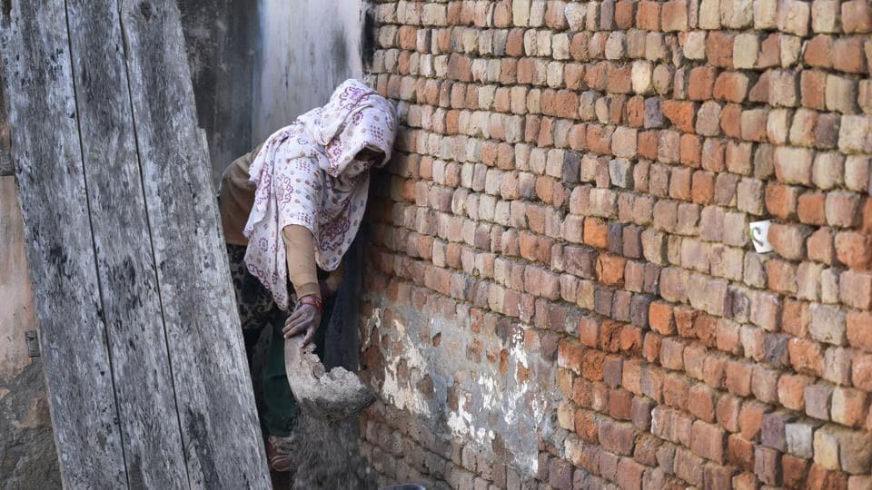 Women manual scavengers in the villages go door-to-door in Uttarakhand, cleaning dry latrines.