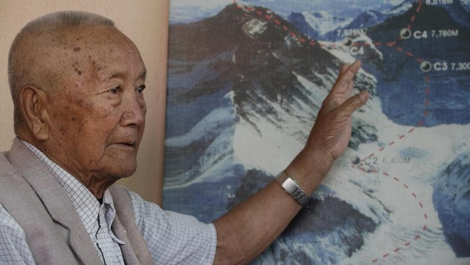 Nepalese climber Min Bahadur Sherchan, points to a picture to describe the trail to Mount Everest. The 85-year-old climber who was once the oldest person to scale the world's highest mountain is heading back to Mount Everest in hopes of scaling the peak and regaining the title. Sherchan is aiming to scale the peak next month when there is window of favourable weather on the summit. (Niranjan Shrestha/AP)