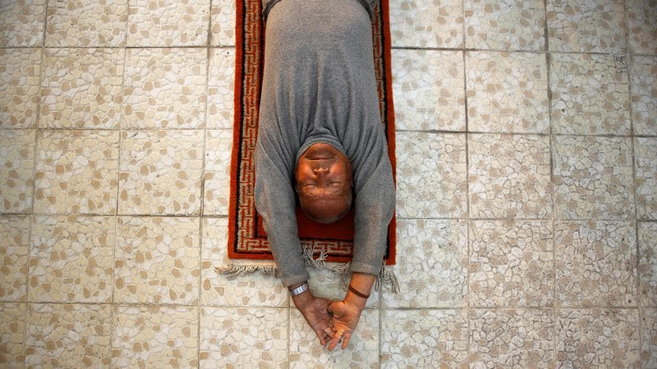 Nepali mountain climber Min Bahadur Sherchan, 85, who will attempt to climb Everest to become the oldest person to conquer the world's highest mountain, performs yoga at his house in Kathmandu, Nepal.  (Navesh Chitrakar/REUTERS)