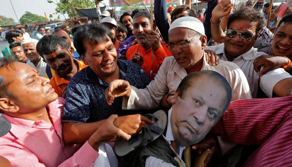 People beat an effigy of Pakistan's Prime Minister Nawaz Sharif during a protest against the death sentence of Kulbhushan Jadhav, in Lucknow.