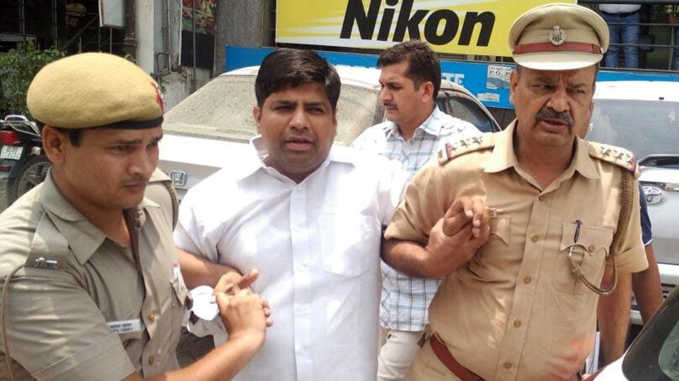 Aam Aadmi Party (AAP) MLA Dinesh Mohaniya arrested by the Delhi Police for allegedly misbehaving with a woman and slapping a 60-year-old man, in New Delhi, on June 25, 2015.
