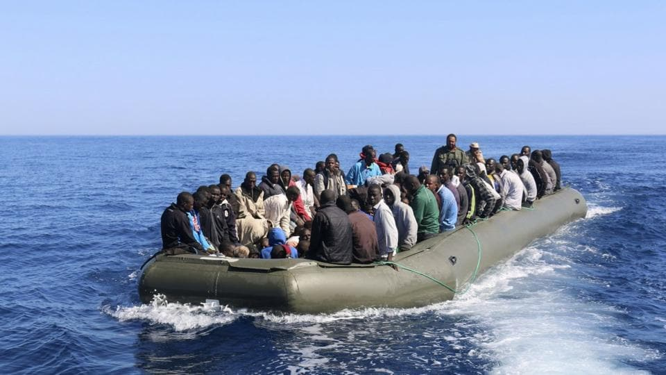 Close to 100 migrants were feared missing after their boat sank off the Libyan coast near Tripoli on Thursday, a coastguard official said.